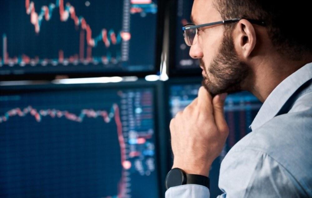 man looking at price charts